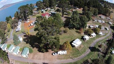 View of Rainbow Pines Tourist Caravan Park, Old Adaminaby, from the air